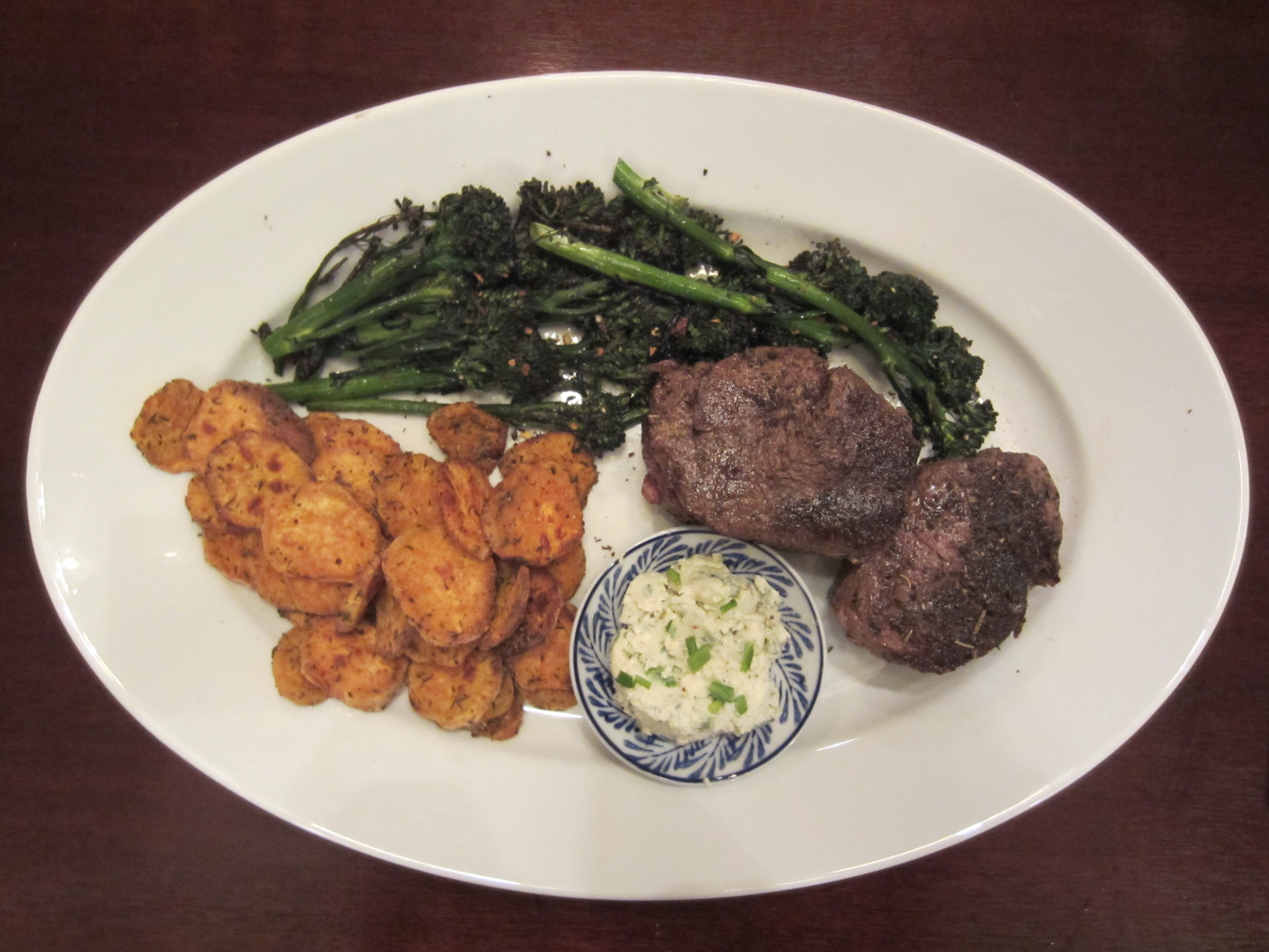 Pan-Seared Beef Tenderloin with Roasted Sweet Potato Coins and Broccolini